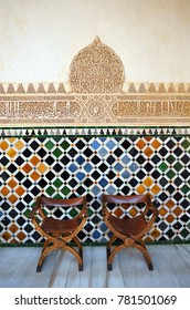 Arab tiles and medieval chair in the Alhambra palace in Granada, Andalusia, Spain