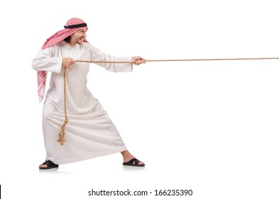 Arab in tug of war concept on white