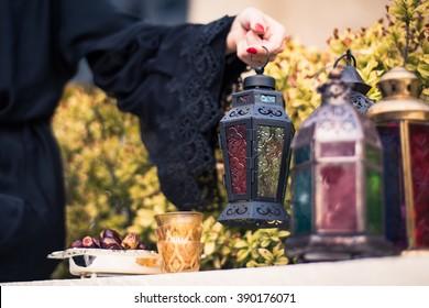 Arab woman in Abaya Holding Arabian Lantern
