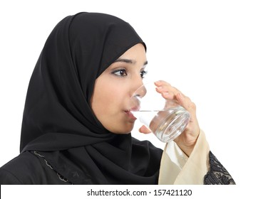 Arab woman drinking water from a glass isolated on a white background