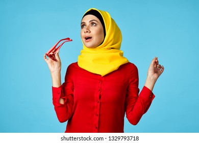 Arab woman with glasses on a blue background