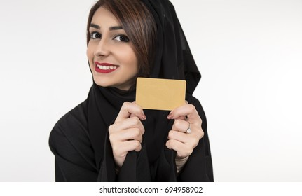 Arab woman holding credit card. Isolated portrait of smiling businesswoman.