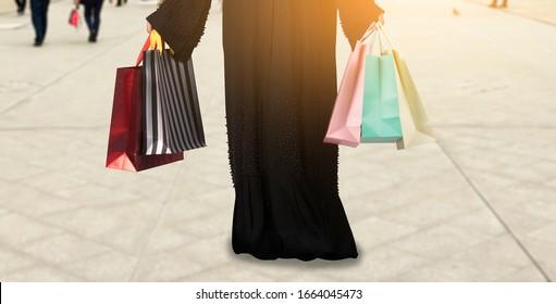 Arab woman holding shopping bags