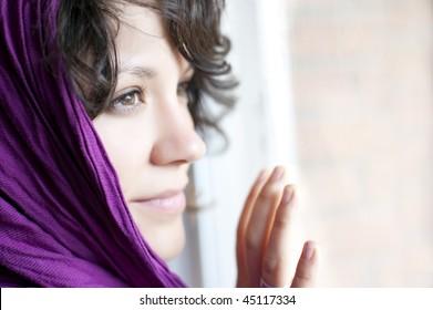Arab woman with purple headscarf.