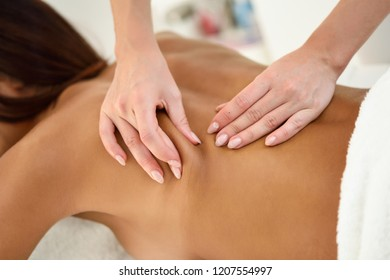 Arab woman receiving back massage in spa wellness center. Beauty and Aesthetic concepts.