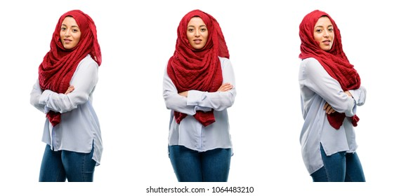 Arab woman wearing hijab with crossed arms confident and happy with a big natural smile laughing isolated over white background