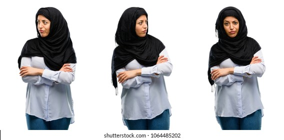 Arab woman wearing hijab irritated and angry expressing negative emotion, annoyed with someone isolated over white background