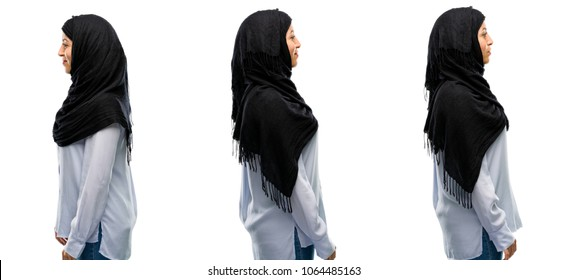 Arab woman wearing hijab side view portrait isolated over white background
