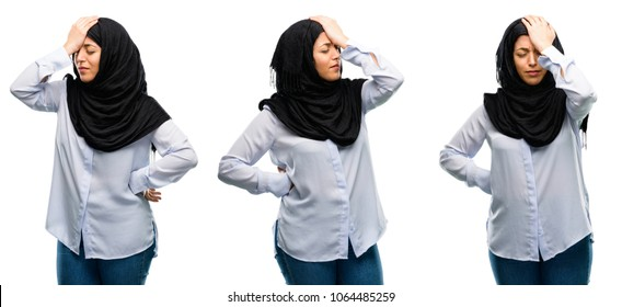 Arab woman wearing hijab stressful keeping hand on head, tired and frustrated isolated over white background
