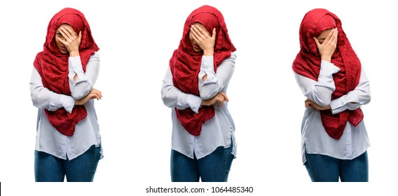 Arab woman wearing hijab stressful keeping hands on head, tired and frustrated isolated over white background
