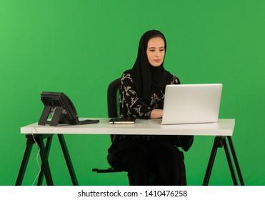 Arab woman working on desk