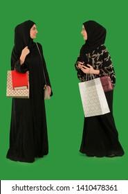 Arab women carrying shopping bags.