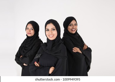 Arab women in traditional dress standing on white background