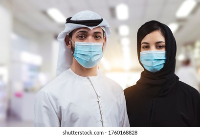 Arab young family wearing a mask for prevent virus at airport. Protection against Coronavirus.