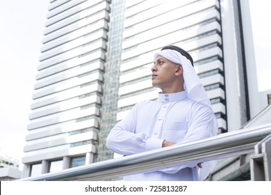 Arab young man looking to The City.