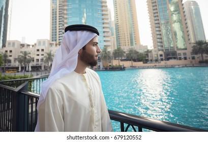 Arab young man looking to Dubai skyline