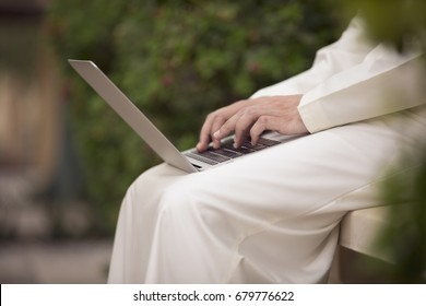 arab young man sitting and working with his laptop