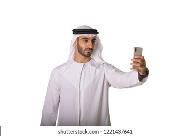 Arab young man taking a selfie picture from his mobile.