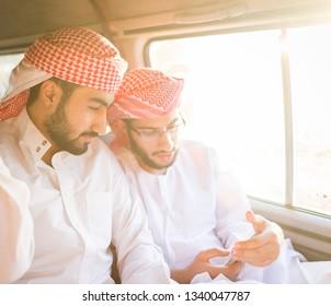 Arab young men traveling
