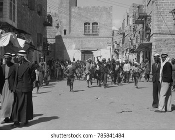 Arab youths running in Bethlehem after burning government offices during Arab Revolt. Sept. 14, 1938