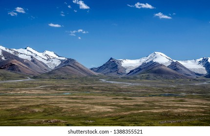 Arabel Syrt - wide valley in the highlands. Tian Shan mountaines in Kyrgyzstan, Asia