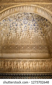 Arabesque caligraphy and Mocarabe Stalactite designs in Comares Palace of Nasrid Alhambra Granada, Andalusia, Spain - April 29, 2015