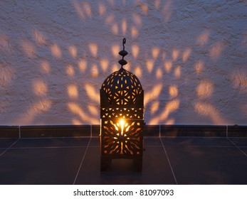 Arabesque - a Moroccan lantern casts shadows on a wall