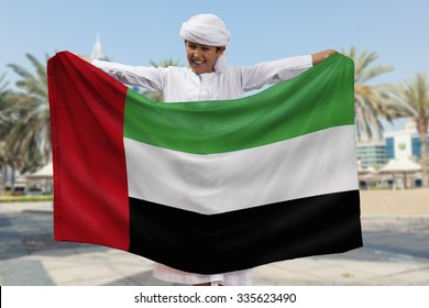 Arabian Boy Holding UAE Flag Outdoors