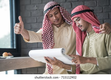 Arabian business people raised thumb up and work together toward a common vision, teamwork concepts.