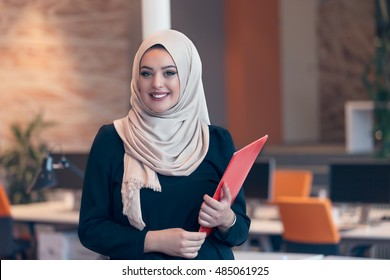 Arabian business woman holding a folder
