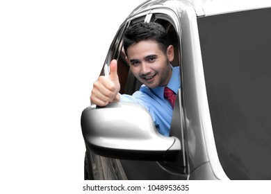 Arabian businessman driving a new car while showing thumb up, isolated on white background