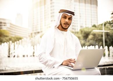 Arabian businessman portrait while using laptop