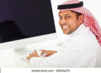 arabian businessman working on a computer in office