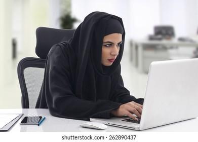 Arabian Businesswoman wearing hijab working on notebook in the office