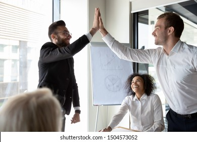 Arabian and Caucasian businessmen greeting each other meet in boardroom before start briefing, multi-ethnic corporate buddies give high five concept of friendship, racial equality, equal opportunities