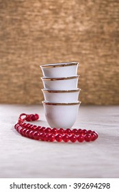 Arabian coffee cups with rosary