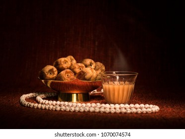 Arabian coffee with dates and rosary