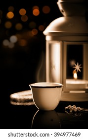 Arabian coffee with  lantern Ramadan mood at night with light decoration in the background.