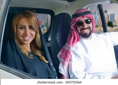 arabian couple in a newely purchased car touring in the city