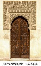 Arabian door style with beautiful mosaics in the Alhambra in Granada