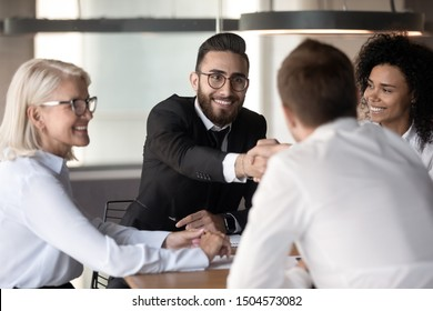 Arabian executive manager shake hands client accomplish successful negotiations closing profitable deal feels satisfied, handshake symbol of gratitude of entities, respect, trust and promise concept