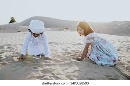 Arabian family spending a weekend in the desert, in Dubai