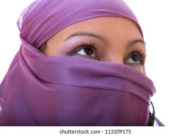 arabian girl in purple shawl isolated on white background