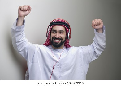 arabian guy dancing while listening to music on headphones