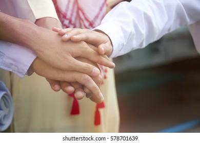 Arabian hands on hands teamwork