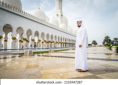 Arabian man at Sheikh Zayed Grand Mosque in Abu Dhabi, United Arab Emirates.