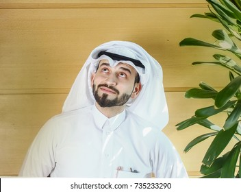 arabian man smiling and looking upwards.