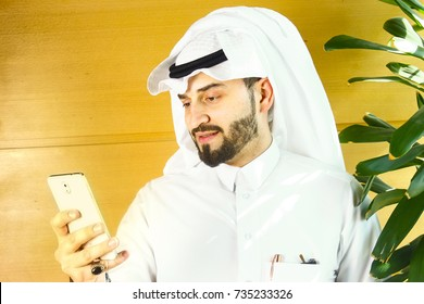 Arabian man using a cellphone.