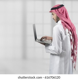 Arabian Man Working On A notebook in his office, business concept
