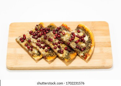 An Arabian manakish bread snack, topped with zattar - a herb mixture based on thyme and sesame seeds